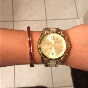 Gold Michael Kors bracelet with red rhinestones